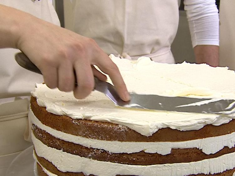 Claire Ptak has been putting the finishing touches on Harry and Meghan's cake inside Buckingham Palace.