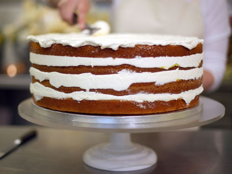 Claire Ptak, owner of Violet Bakery in Hackney, east London, puts finishing touches to the cake for the wedding