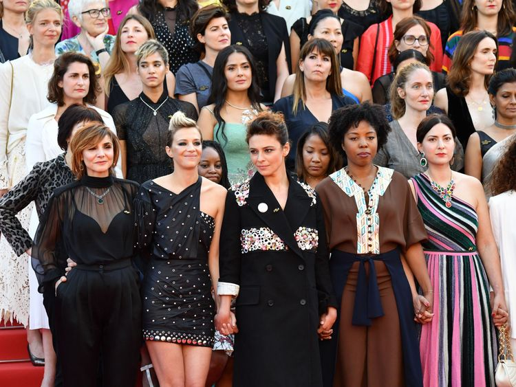 Directors, actresses and industry representatives pose on the red carpet in protest of the lack of female filmmakers honored throughout the history of the festival at the screening of 'Girls Of The Sun (Les Filles Du Soleil)' during the 71st annual Cannes Film Festival at the Palais des Festivals on May 12, 2018 in Cannes, southeastern France. - Only 82 films in competition in the official selection have been directed by women since the inception of the Cannes Film Festival whereas 1,645 films