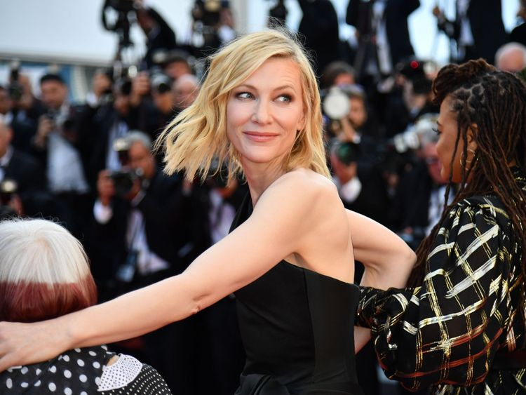 Australian actress Cate Blanchett (C) walks the red carpet in protest of the lack of female filmmakers honored throughout the history of the festival at the screening of 'Girls Of The Sun (Les Filles Du Soleil)' during the 71st annual Cannes Film Festival at the Palais des Festivals on May 12, 2018 in Cannes, southeastern France. - Only 82 films in competition in the official selection have been directed by women since the inception of the Cannes Film Festival whereas 1,645 films in the past 71