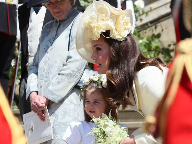 The Duchess of Cambridge and Princess Charlotte outside St George's Chapel in Windsor Castle after the wedding of Prince Harry and Meghan Markle. PRESS ASSOCIATION Photo. Picture date: Saturday May 19, 2018. See PA story ROYAL Wedding. Photo credit should read: Brian Lawless/PA Wire