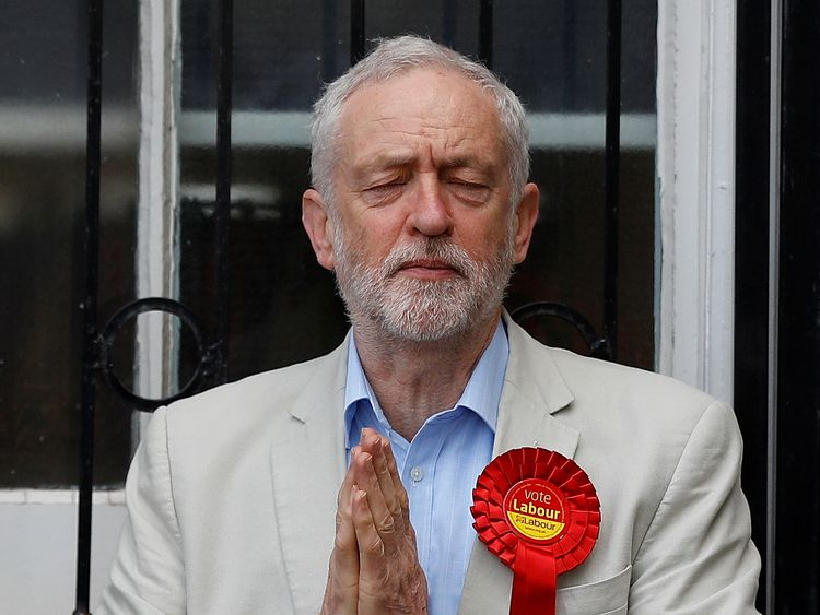Britain's Labour Party leader Jeremy Corbyn gestures after voting in local government elections in London...