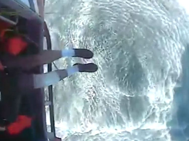 The fisherman can be seen with a bandage on his right leg after the rescue