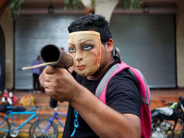 A demonstrator poses for a photo with his homemade mortar in a protest against Nicaragua's President Daniel Ortega's government