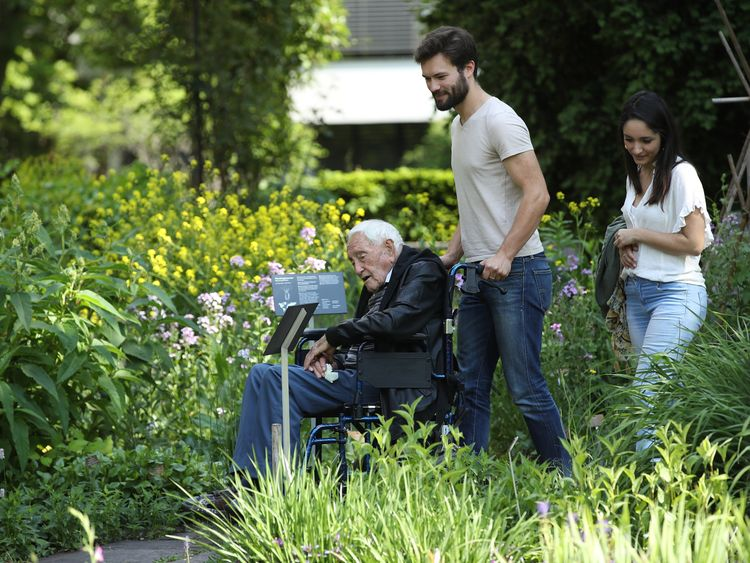 Dr Goodall visited botanical gardens on Wednesday with three of his grandchildren