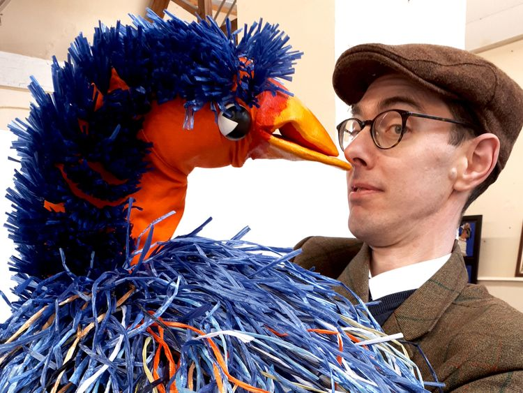 Principal auctioneer Richard Edmonds poses with the Emu puppet