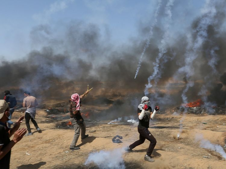 Tear gas canisters are fired by Israeli forces at Palestinian demonstrators