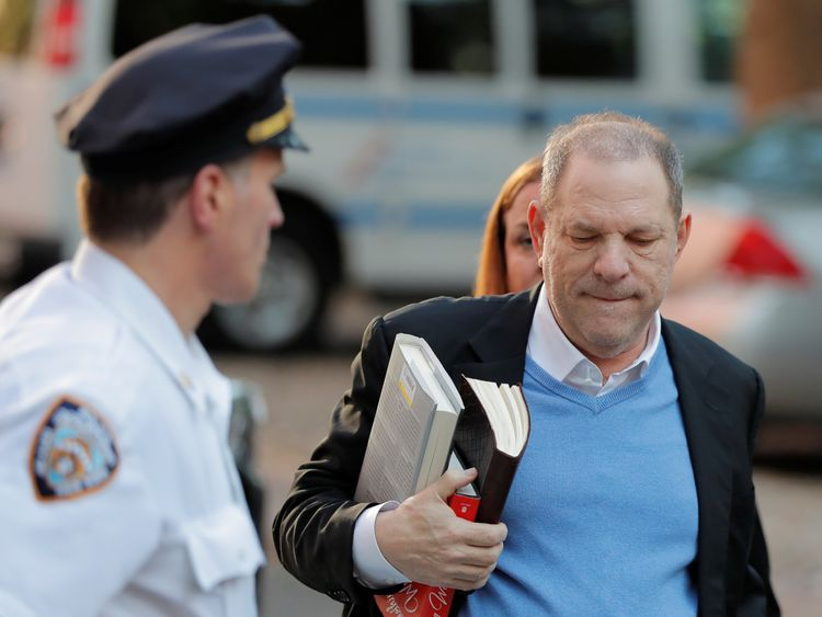 Harvey Weinstein was carrying two non-fiction hardbacks and a leather-bound book as he prepared to face police