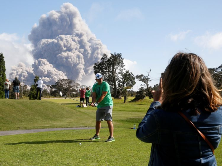 Sean Bezecny, 46, of Houston, Texas, played golf as ash erupted from the Halemaumau Crater