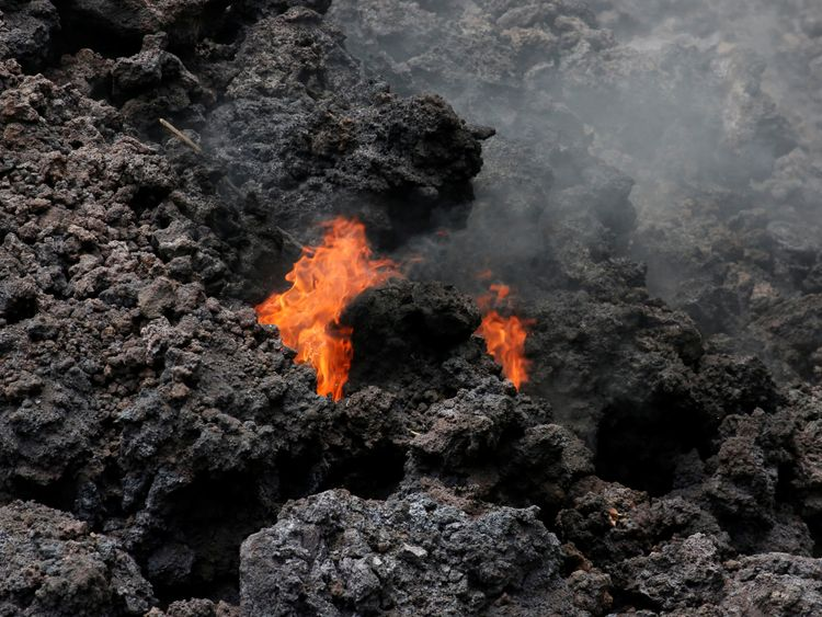 Flames are seen in a lava flow on Highway 137 southeast of Pahoa