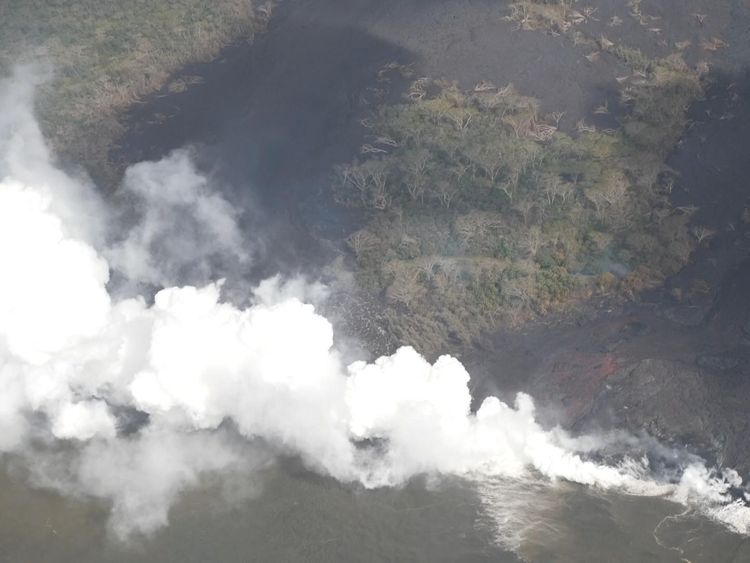 Lava from Mount Kilauea enters the Pacific Ocean