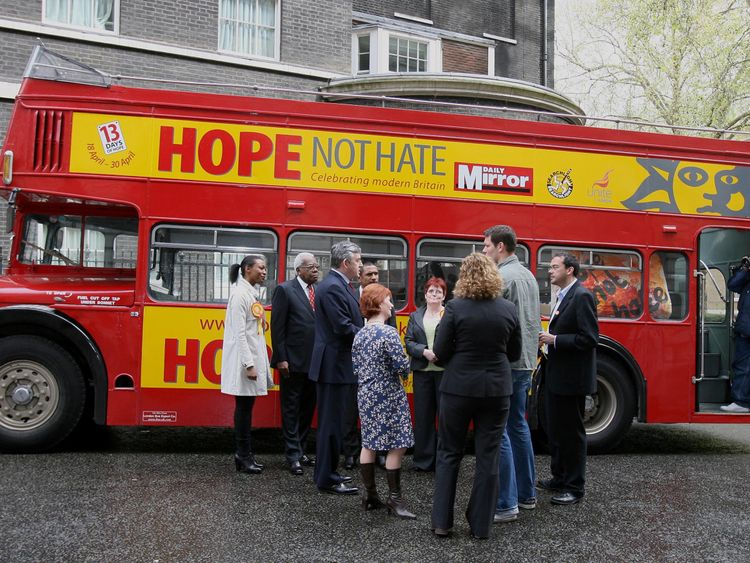 Prime Minister Gordon Brown (3rd from left) meets war veterans and actor Jason Isaacs (left) as he stands by the Hope Not Hate bus in London during his campaign for the forthcoming local elections.