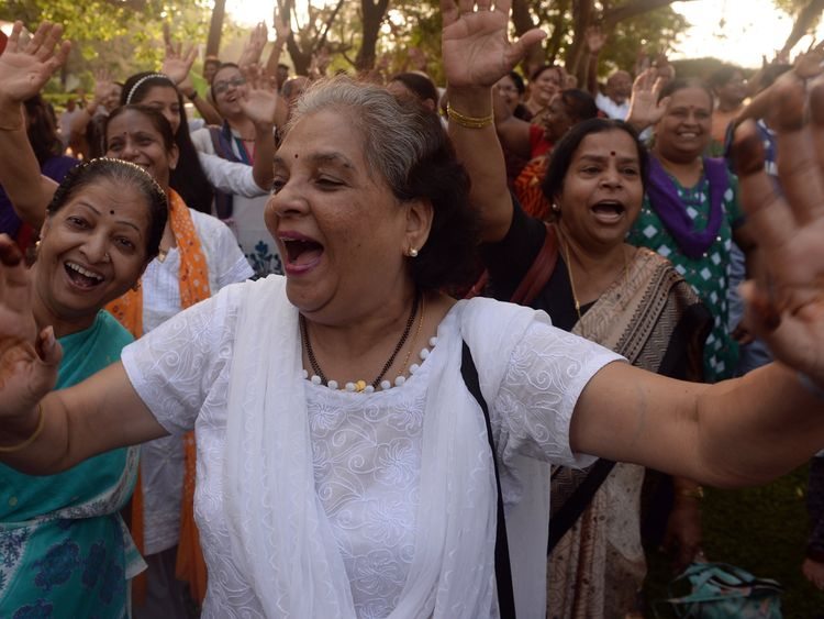 Indian women attend a laughter yoga session at a park during a World Laughter Day event in Mumbai