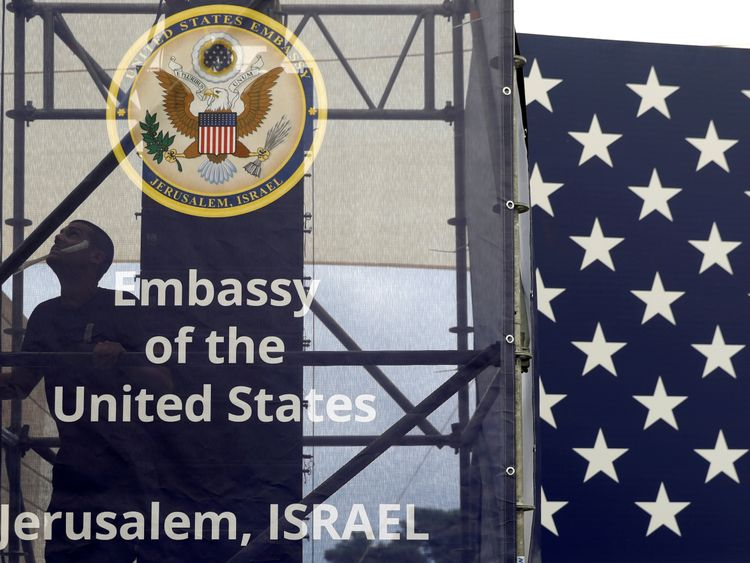 A worker is seen inside the new U.S. embassy compound during preparations for its opening ceremony in Jerusalem