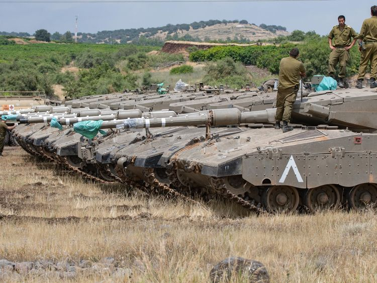 Israeli tanks were seen lined up in the Golan Heights on Thursday