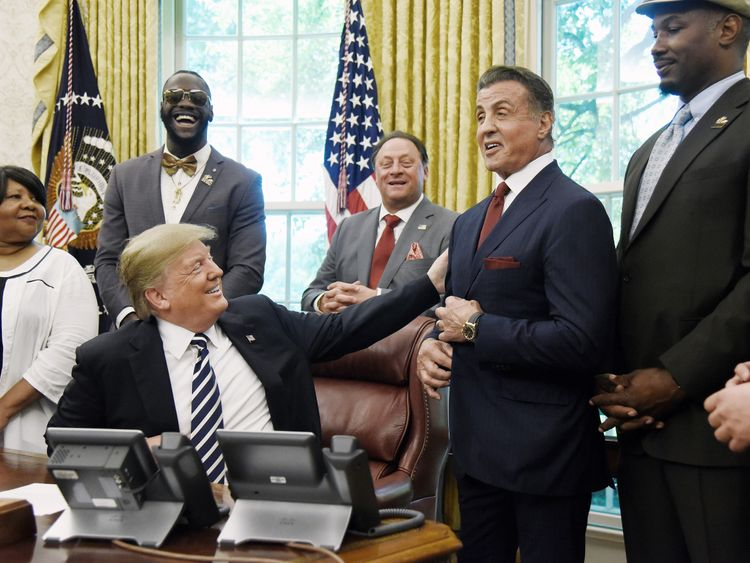 Donald Trump reaches out to Sylvester Stallone as Lennox Lewis and Deontay Wilder look on