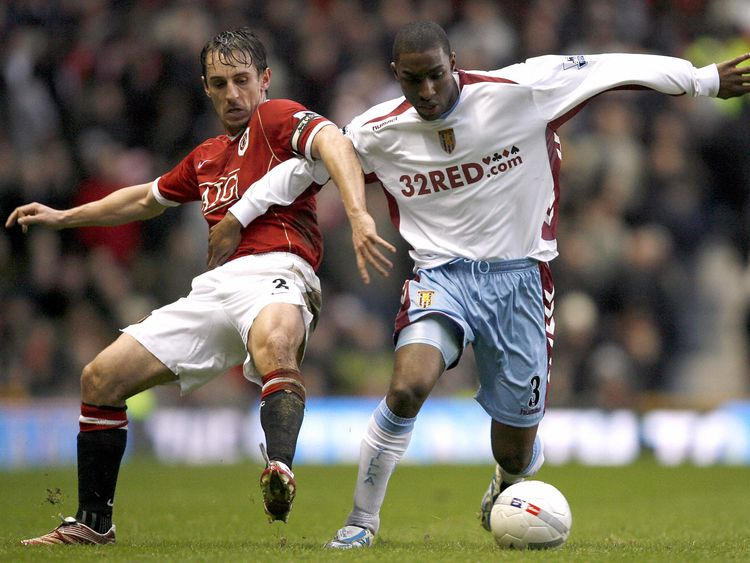 Samuel challenges Manchester United's Gary Neville in 2007