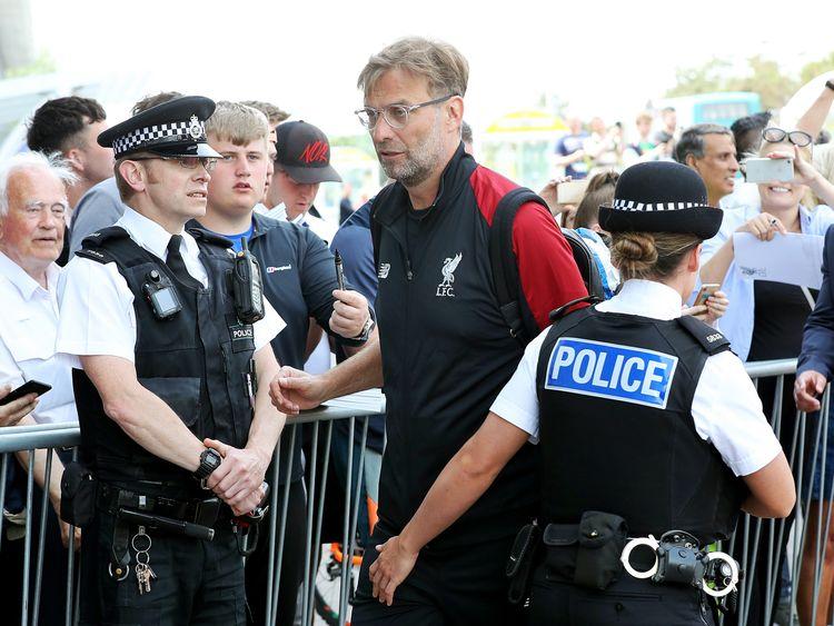 Manager Jurgen Klopp arrives at Liverpool John Lennon Airport with his team on Thursday