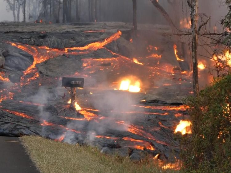 Hawaiians watch lava eat their street