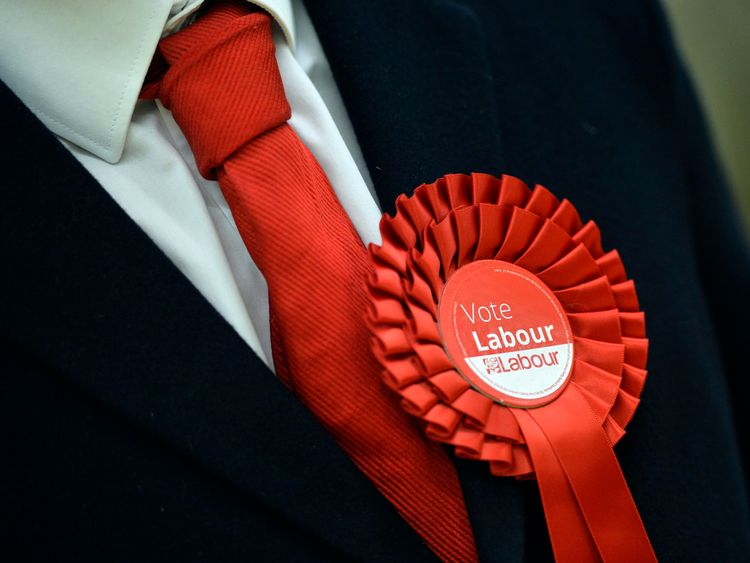 A Labour Party supporter wears a rosette in support of the political party during the election count for Basildon at the Sports Village in Basildon, Essex. PRESS ASSOCIATION Photo. Picture date: Friday May 6, 2016. See PA story POLITICS Election. Photo credit should read: Hannah McKay/PA Wire .