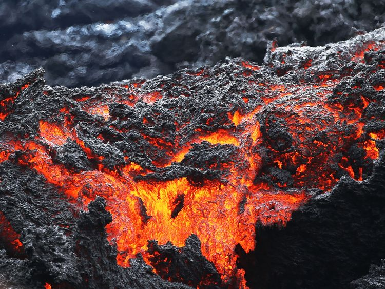 Lava flows at a lava fissure in the aftermath of eruptions from the Kilauea volcano on Hawaii's Big Island, on May 12, 2018 in Pahoa, Hawaii