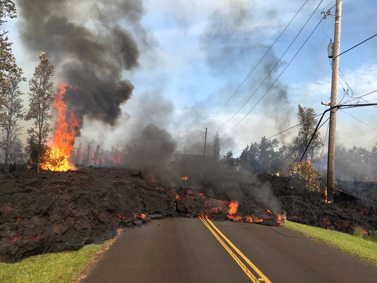 Lava advances along a street near a fissure in Leilani Estates, on Kilauea Volcano's lower East Rift...