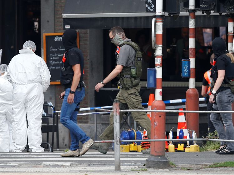 Forensics officers examine the scene in Liege
