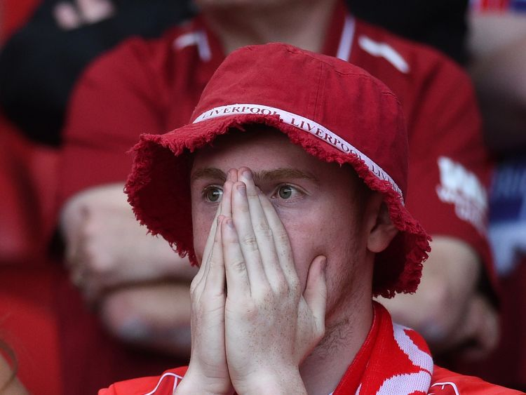 A Liverpool fan watches on as his side lose to Real Madrid