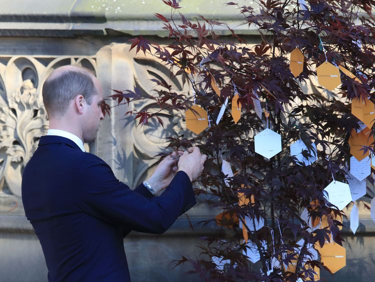 The Duke of Cambridge leaves a message on a 'Tree of Hope' in Manchester