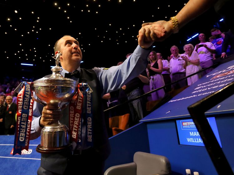 Mark Williams with the trophy after winning the 2018 Betfred World Championship at The Crucible, Sheffield. PRESS ASSOCIATION Photo. Picture date: Monday May 7, 2018. See PA story SNOOKER World. Photo credit should read: Richard Sellers/PA Wire