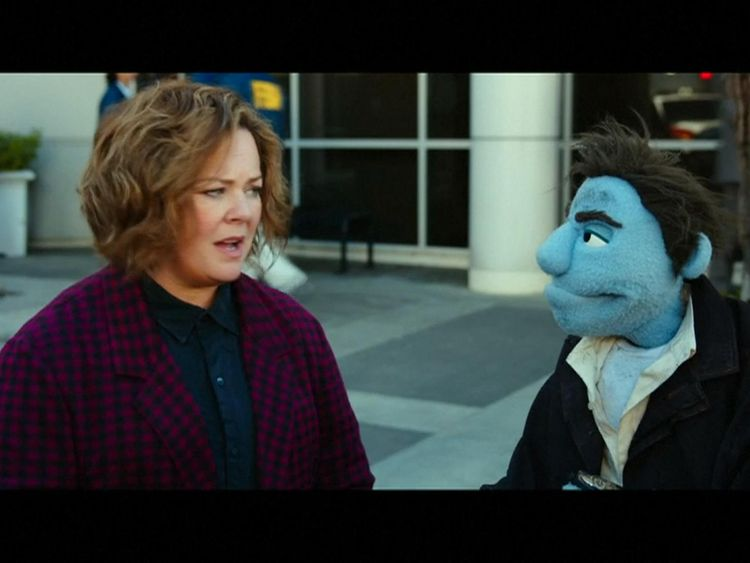 Melissa McCarthy teams up with a puppet partner to investigate the deaths