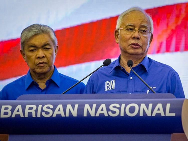 Najib Razak, right, was defeated in the election after an investment fund scandal