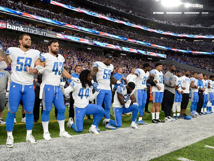 Jalen Reeves-Maybin left and teammate Steve Longa of the Detroit Lions take a knee during the anthem