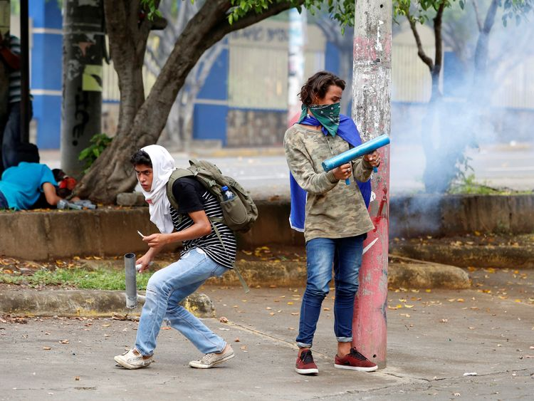 A demonstrator fires a homemade mortar towards the riot police during a protest against Nicaragua's President Daniel Ortega's government in Managua