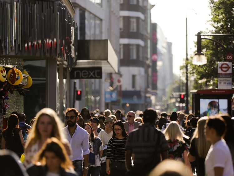Pedestrians throng the busy Oxford street in central London on August 17, 2016