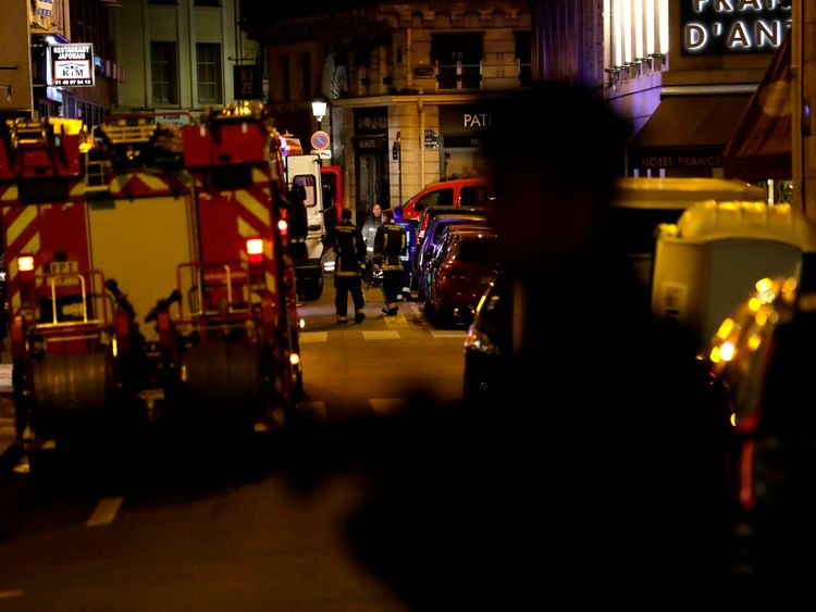 Policemen stand guard in Paris centre past firefighters vehicles after one person was killed and several injured by a man armed with a knife, who was shot dead by police in Paris on May 12, 2018. - The attack took place near the city's main opera house. Police indicated that the attacker had been 'overcome' and his motives are unknown. (Photo by Thomas SAMSON / AFP) (Photo credit should read THOMAS SAMSON/AFP/Getty Images)