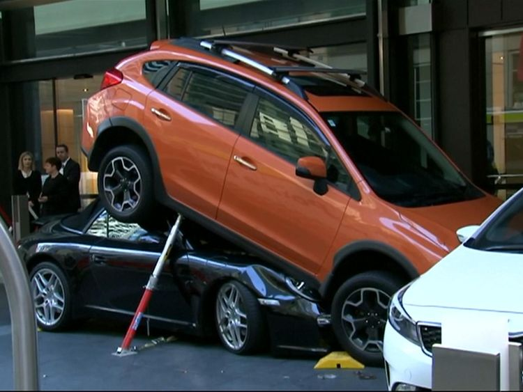 A hotel valet had a lucky escape after a sports car he was parking ended up underneath another vehicle