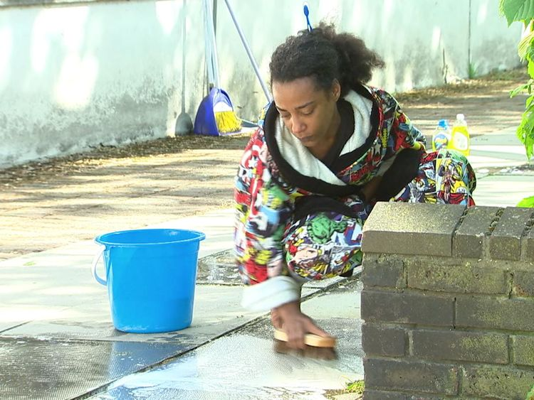 Pretana Morgan washes away blood from the floor after her 17-year-old son Rhyhiem Ainsworth Barton shot dead