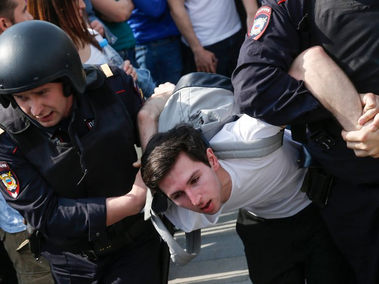 Police officers detain a protester at an anti-Putin rally in Moscow
