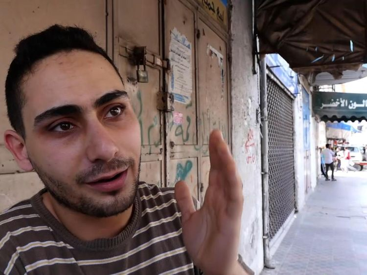 Rajaee El Jaro, is a musician and owns a shop in Gaza selling musical instruments and camera equipment
