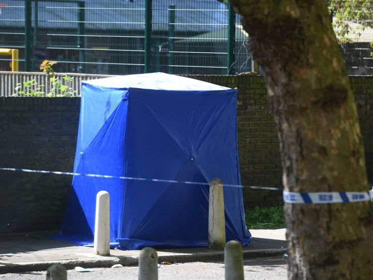 A forensic blue tent at the scene where the 17-year-old victim was found with a fatal gunshot wound
