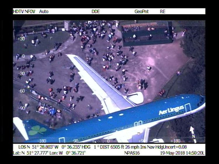 The Aer Lingus plane flew in between the police helicopter and the royal wedding crowds in Windsor. Pic: NPAS Benson