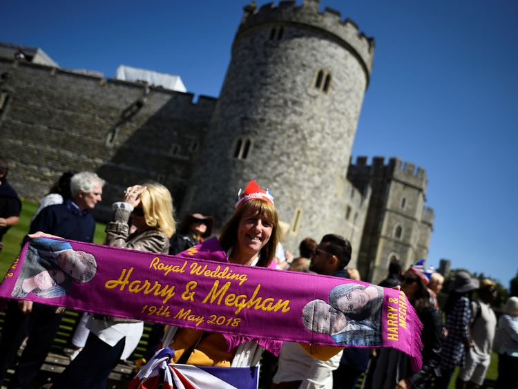 woman holds up a commemorative scarf during rehearsals for the wedding of Britain's Prince Harry and Meghan Markle