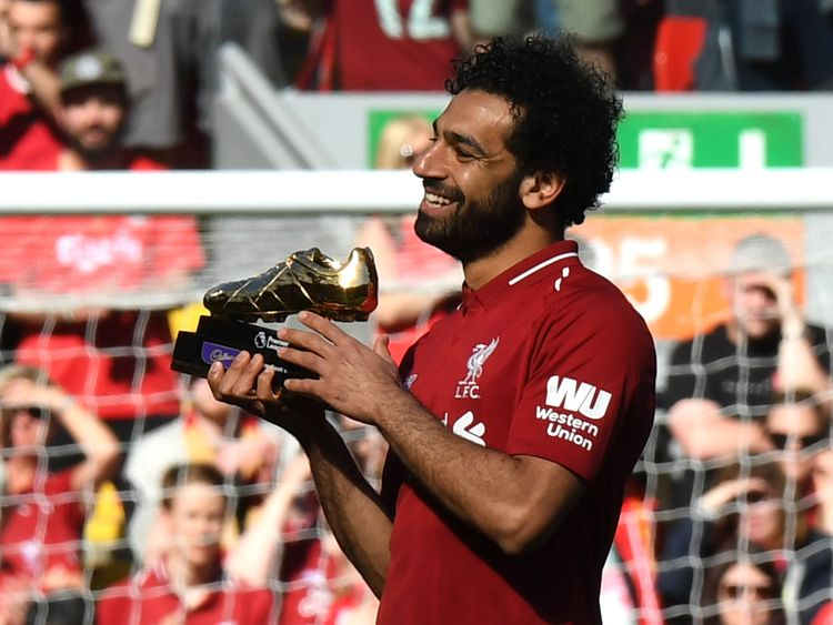 Salah celebrates after being awarded the golden boot award