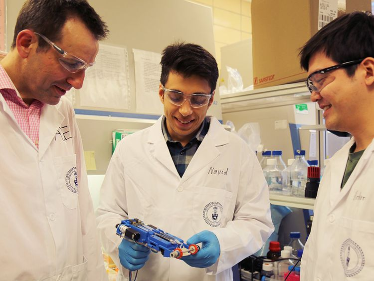 From left to right, Associate Professor Axel Guenther, Navid Hakimi and Richard Cheng have created the first 'skin printer' that forms tissues in situ for application to wounds. Credit: Liz Do