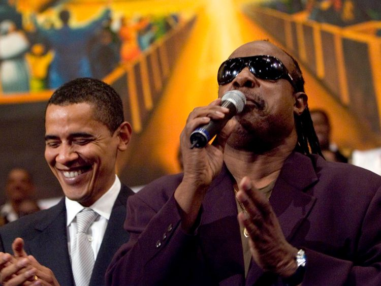 LOS ANGELES - APRIL 29: Democratic presidential hopeful Senator Barack Obama (D-IL) (L) is joined by a singing Stevie Wonder during a service commemorating the Los Angeles riots at the First AME Church April 29, 2007 in Los Angeles, California. The Los Angeles riots, which started 15 years ago on April 29, 1992, lasted three days and resulted in 53 deaths.  (Photo by Ann Johansson/Getty Images) *** Local Caption *** Barack Obama;Stevie Wonder