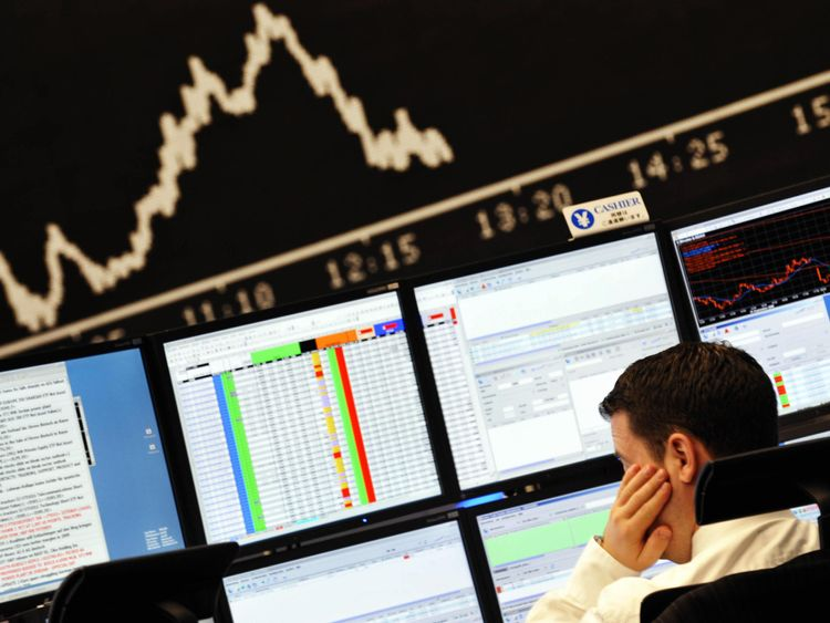 Traders look at screens during a stock market fall
