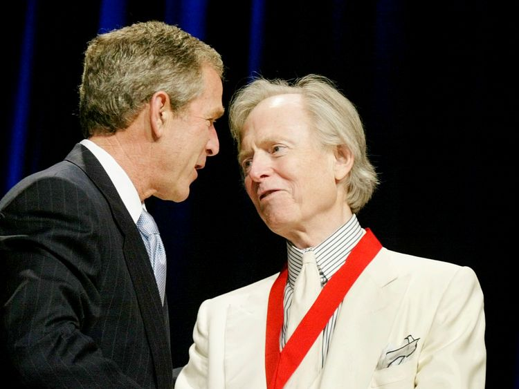 Wolfe receives the  National Humanities Medal from President George W. Bush in 2002