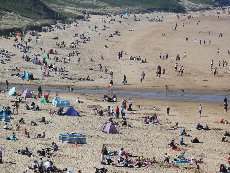 People enjoy the sun on Tynemouth Beach in North Tyneside on the North East coast. Sun worshippers are set to sizzle in the spring heatwave, with Bank Holiday Monday forecast to be the hottest since records began. PRESS ASSOCIATION Photo. Picture date: Sunday May 6, 2018. See PA story WEATHER Hot. Photo credit should read: Owen Humphreys/PA Wire