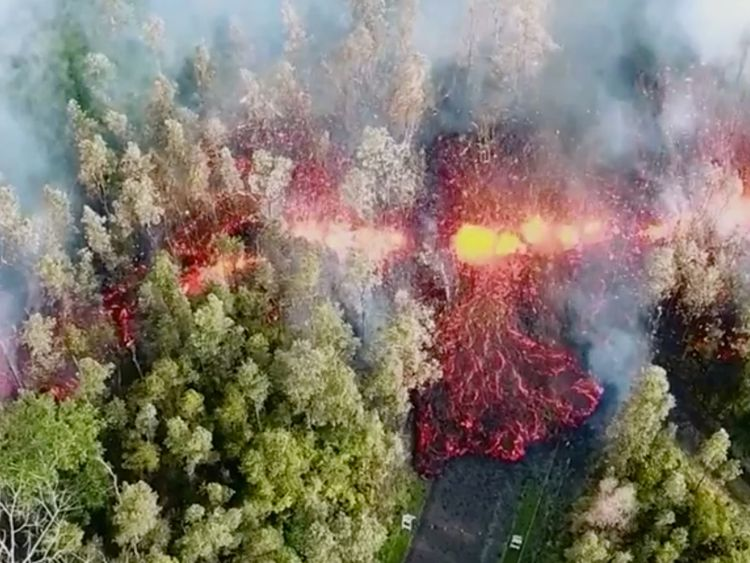 Lava emerges from the ground after Kilauea Volcano erupted, on Hawaii's Big Island